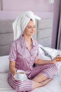 woman meditating with tea