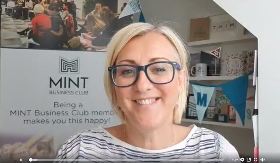 Nicola with MINT Business Club sign
